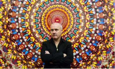 Damien Hirst poses in front of his work I Am Become Death, Shatterer of Worlds