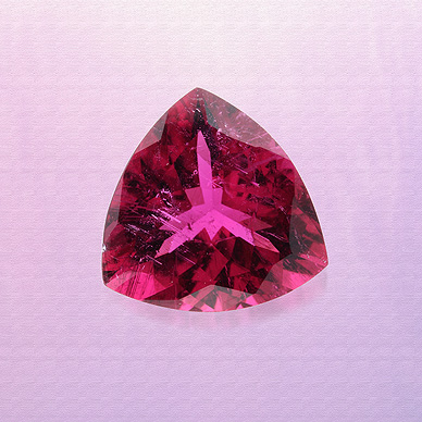 A triangle-shaped rubellite tourmaline, weighing approximately 4.67 carats.Everything that Glitters, The Story by Saffronart