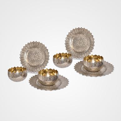 Kashmir Parcel Gilt Set of Four Finger Bowls and Plates in 'Shawl' Pattern c. 1900. http://www.saffronart.com/fixedjewelry/PieceDetails.aspx?iid=35971&a=