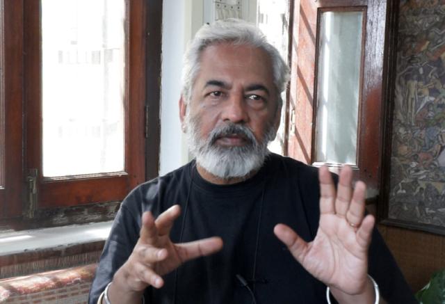 Photographer, Dinesh Khanna by Professor Kathryn Myers