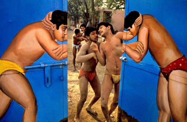 Wrestlers through the painted gate. Paharganj, Delhi, India.2009 Image Credit; http://www.tasveerarts.com/group-shows/magnums-vision-of-india/view-individual-images/?p=21