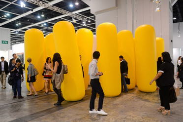 "Seung Yul Oh 'Periphery' (2013) A ""forest"" of yellow balloon columns; Image Credit http://www.yatzer.com/highlights-art-basel-hong-kong-2013"