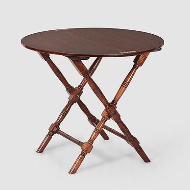 A Circular Folding Campaign Table, Lot 7