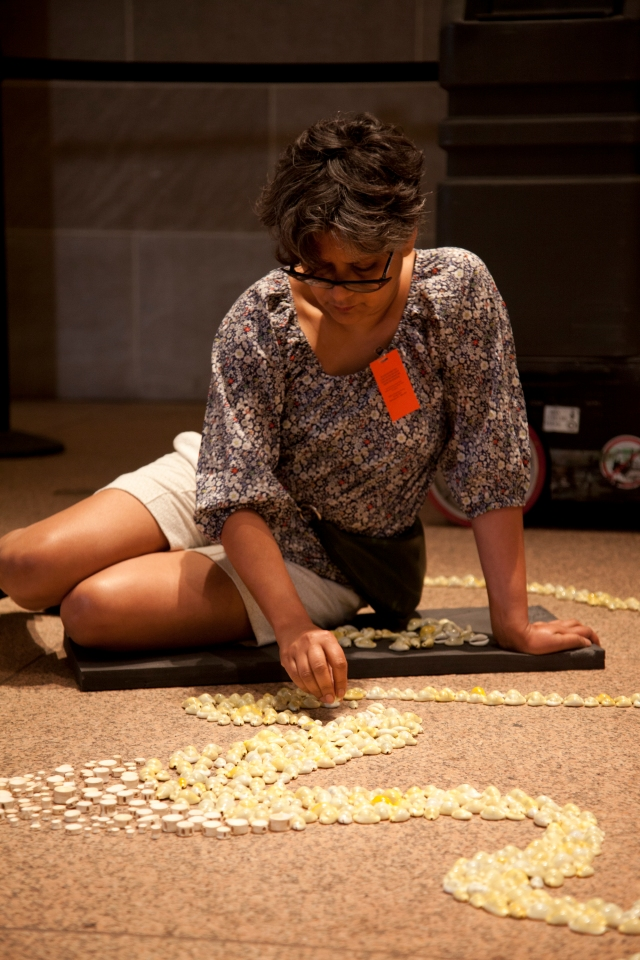 Rina Banerjee Working on the Installation,A world Lost: after the  original island, single land mass fractured, after populations migrated,  after pollution revealed itself and as cultural locations once separated  merged, after the splitting of Adam and Eve, Shiva and Shakti, of race  black and white, of culture East and West, after animals diminished,  after the seas' corals did exterminate, after this and at last imagine all  water evaporated…this after Columbus found it we lost it imagine this Rina Banerjee (b. 1963)  2013 Photo by Hutomo Wicaksono