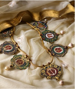 Just when you thought Lord Balaji had the last laugh,  the Enamel and Pearl Srinathji Necklace (Lot 23) shows up. Image Credit: http://www.saffronart.com/customauctions/PreWork.aspx?l=9157