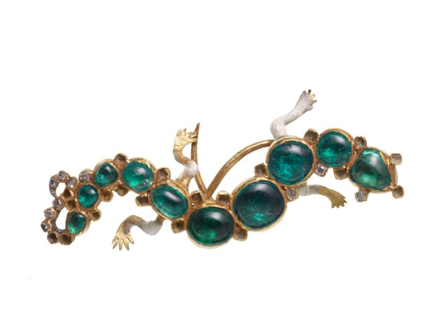 A salamander brooch made from Colombian cabochon emeralds and table-cut diamonds from India, set in gold. It originates from somewhere between the 16th and 17th century, when the salamander had particular symbolic significance.