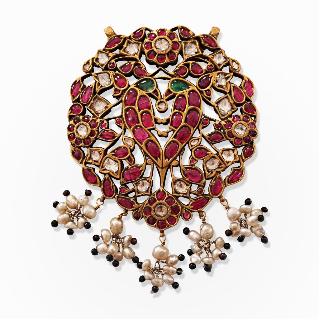 A gem-set pendant depicting two parrots Source: http://www.saffronart.com/fixedjewelry/PieceDetails.aspx?iid=39821&pt=2&eid=3703