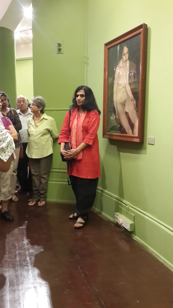 Yashodhara Dalmia next to Amrita's 1933 painting, Professional Model