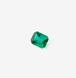 An unmounted emerald-cut emerald, the most common cut although emeralds are available in other cuts too http://www.saffronart.com/fixedjewelry/PieceDetails.aspx?iid=41314&a=