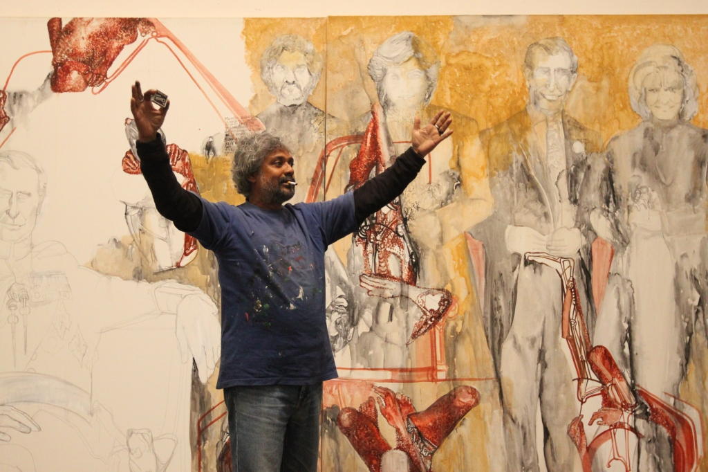 """""""I enjoy the pose Probir Gupta strikes - like a conjurer making phantoms appear on the canvas in the background. His smile almost dares the viewer to catch a glimpse of the illusion."""""""
